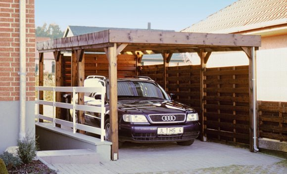Carport aus Holz mit Flachdach von SCHNOOR