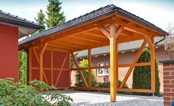 Carport mit Holzstützen für Nutzenklasse von SCHNOOR